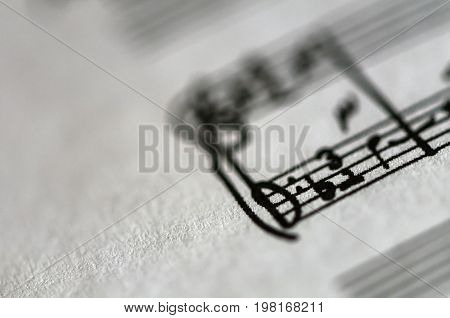 Detail of a music sheet score page. Shallow depth of field.