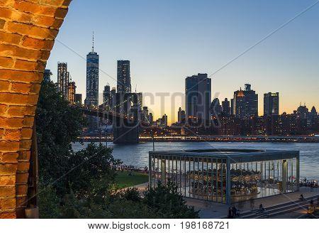 New York Brooklyn Bridge at night with Carousel