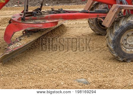 Close Up Of Motor Grader Working On Gravel Leveling 3