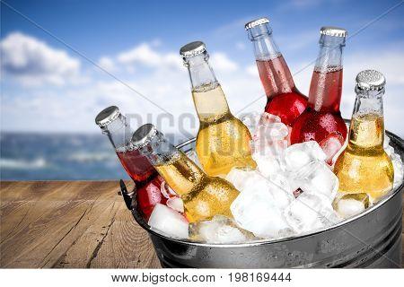 Ice bottles beer bar color background festive