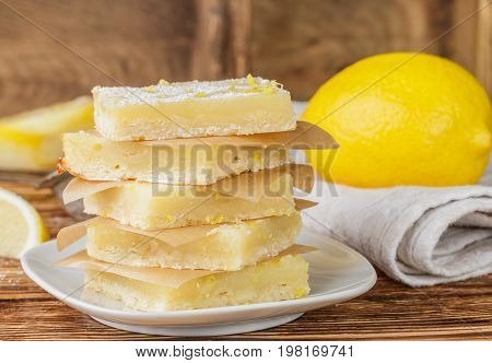 Lemon bars (lemon squares) with powdered sugar. A traditional American dessert. Selective focus