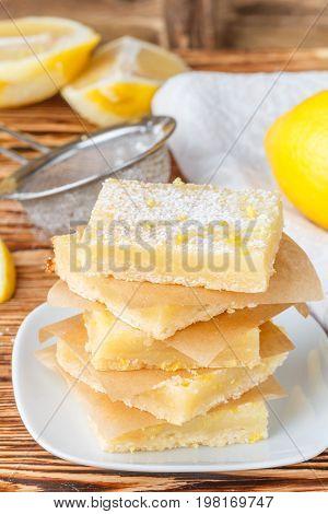 Lemon bars (lemon squares) with powdered sugar. A traditional American dessert. Selective focus