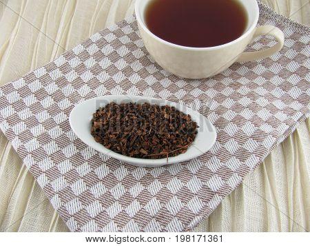 Freshly brewed hot and brown honeybush tea