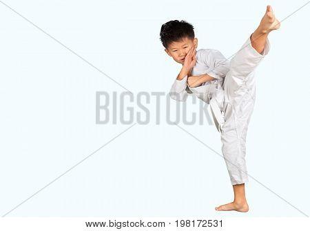 Little boy asian karate sport strike holding