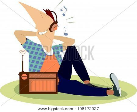 Listening the radio man isolated. Smiling man sits on the floor and listens the radio in headphones