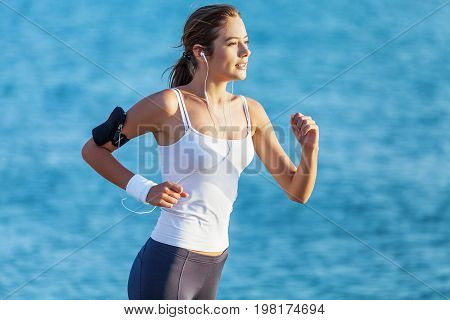 Young woman beach run running young adult sport
