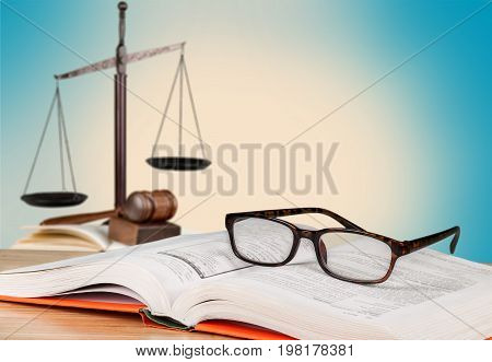 Justice book glasses scales background paper isolated