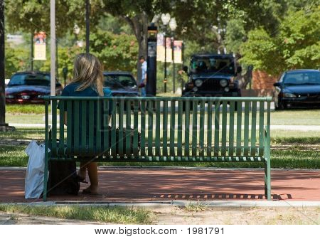 Woman Sitting On A Bench 2