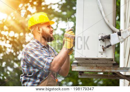 Yellow man helmet uniform he background view