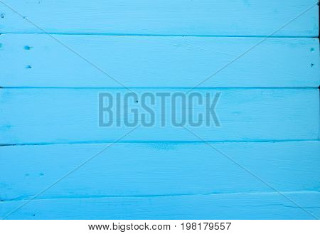 Wooden background. Texture, the surface of the old boards from natural wood with different shades of bright blue, aquamarine, turquoise color. The top view. Close-up. The stock photos.