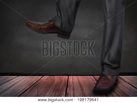 Digital composite of Mans legs and feet on wooden floor