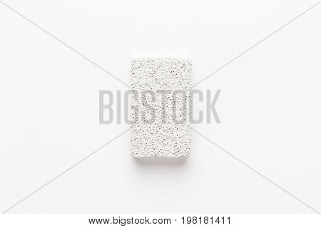 white pumice-stone. pumice-stone on the white background. white pumice-stone not isolated. white pumice-stone central composition
