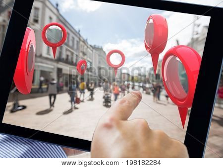 Digital composite of Holding tablet and Location pointer markers in city street