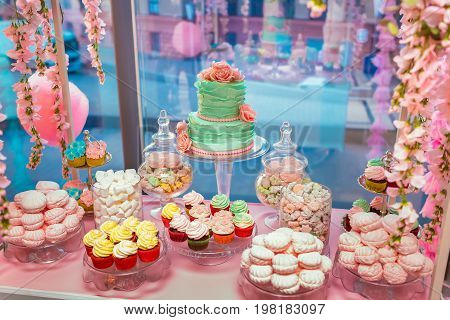Candy Bar. Delicious Sweet Buffet With Cupcakes And Wedding Cake. Sweet Holiday Buffet With Marshmal