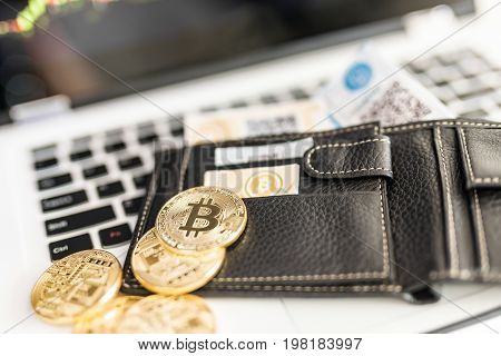 Virtual currency wallet. Bitcoin gold coin and printed encrypted money with QR code. Cryptocurrency concept.