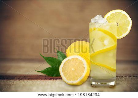 Glass lemon cocktails table color background party