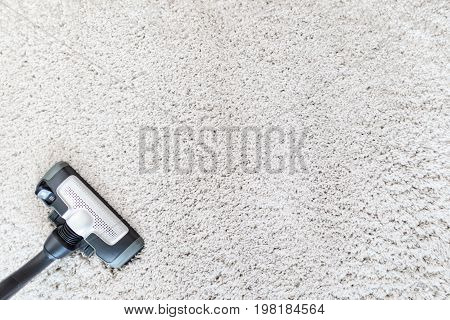 Cleaning carpet hoover. Carpet texture background. Cleanliness.