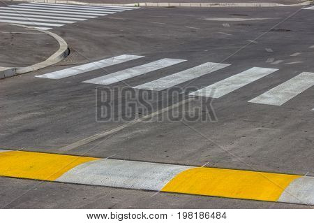 Freshly Painted Crosswalk And Speed Bump
