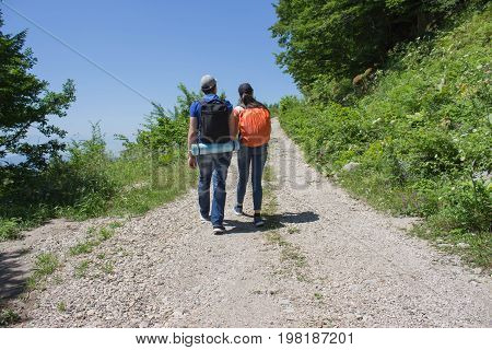 Active and healthy lifestyle on summer vacation and weekend tour. Active hikers. Travel adventure and hiking activity. Two young Tourists With Backpacks travel
