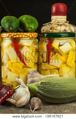 Zucchini slices in herbal vinegar with herbs and filled with canning container. Diet or health food concept