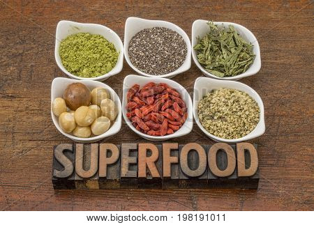 superfood abstract (matcha green tea, chia seeds, stevia herb, macadamia nuts, goji berry and hemp seed hearts) with a text in vintage letterpress wood type
