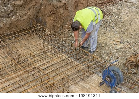 Tying Reinforcing Steel Bars