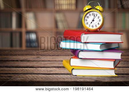 Clock books alarm background nobody paper closeup