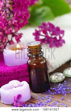 Spa Setting With Candles, Aroma Oil And Lilac