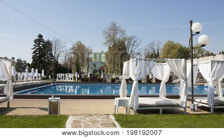 SAINTS CONSTANTINE AND HELENA, BULGARIA - APRIL 27, 2015: swimming pool of Gran Hotel Varna in Saints Constantine and Helena, the oldest first sea resort of Bulgaria, exists from 19 century.