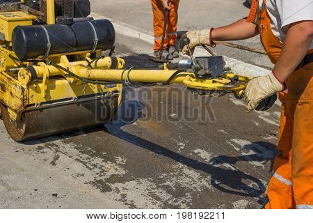 Workers Installing Asphalt Speed Bump