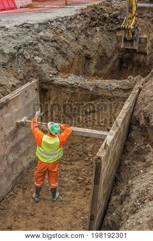 Working On Trench Construction
