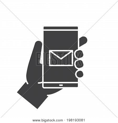 Hand holding smartphone glyph icon. Silhouette symbol. Smart phone sms message. Negative space. Vector isolated illustration