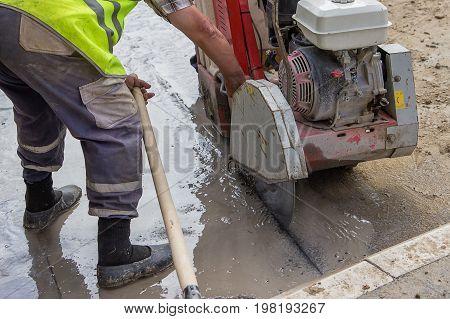 Cutting Asphalt Road With Diamond Saw Blade