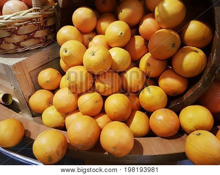 Still image displayed of abundance of oranges flowing from a bucket for sale