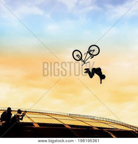Extrem Sport. Silhouette of a Young man doing a jump with a bmx bike on the background of Bright sky. Risky moment of falling falls into the frames of photo correspondents