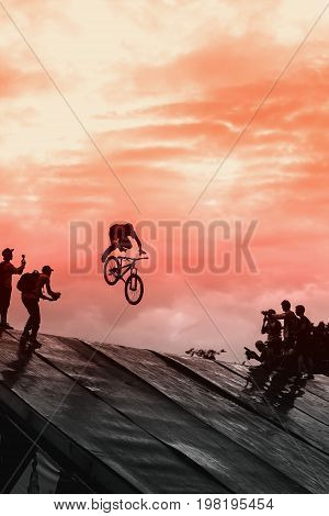 Extrem Sport of youth. Beautiful but risky performance. Unidentified BMX rider making a bike jump