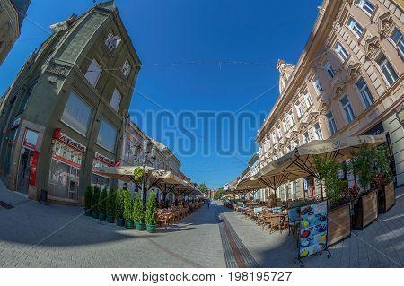 NOVI SAD SERBIA - JULY 30 2017: Dunavska Street one of the oldest streets in center of Novi Sad. A pedestrian zone with pubs restaurants boutique.
