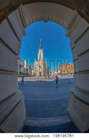NOVI SAD SERBIA - JULY 30 2017: View of the Liberty Square (Trg. Slobode) with Mary Church and old buildings. One of the cities designated as the European capital of culture in 2021.
