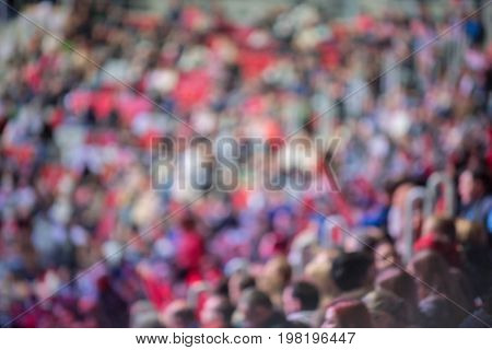 Blurred crowd of spectators on a stadium bleachers at a sporting event
