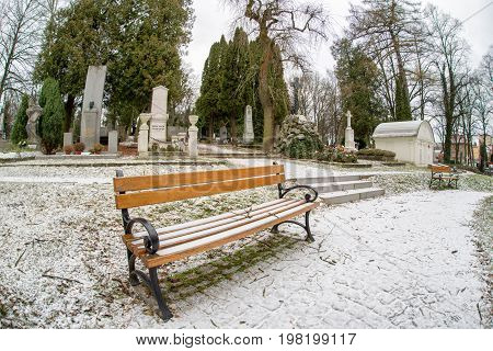 MARTIN SLOVAKIA - DECEMBER 15: Empty bench in Slovak national cemetery on December 15 2016 in Martin
