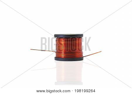 Copper coil Ferrite core inductor on white background. passive two-terminal electrical component that stores electrical energy in a magnetic field.