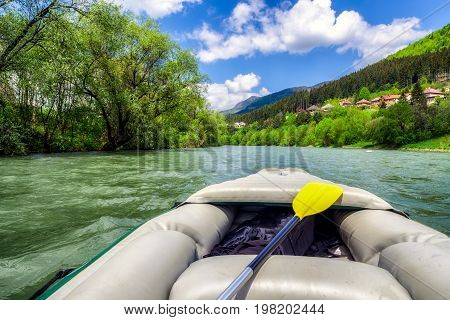 Rafting on river Vah in Slovakia. Boat on river