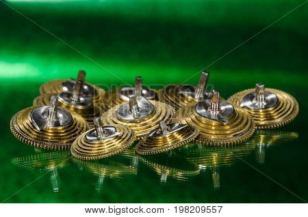 Watch Repair: Vintage Pocket Watch Fusee Cones Resting on a Green Surface