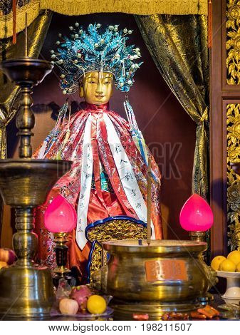 Shanghai, China - Nov 6, 2016: In the 600-year-old Old City God Temple. A female Taoist deity revered and placed at an ornate altar.