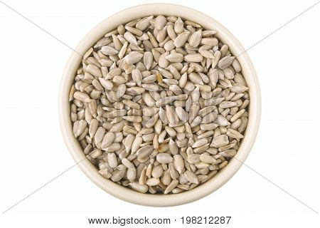 Hulled sunflower seeds in a pot isolated on white background