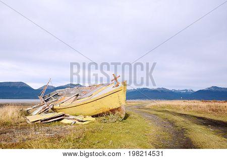Old wooden boat abandoned ashore. Ushuaia, Argentina