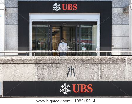GENEVA SWITZERLAND - JUNE 19 2017: Man entering a local branch of UBS (Union Bank Switerland) in Geneva. UBS is one of the main banks of the country famous for its bank secrecy