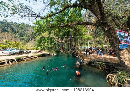 VANG VIENG LAOS - MARCH 14 2017: Tourists swimming in Blue Lagoon located close to the city of Vang Vieng Laos.