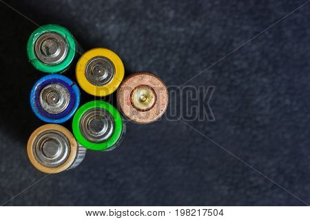 Used batteries. Horizontal shot.6 multicolored used electric batteries view from above