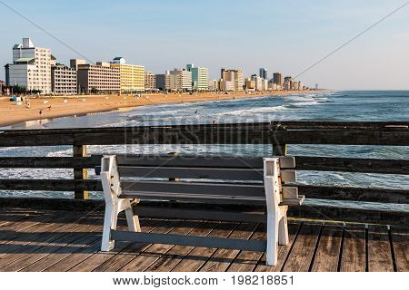 VIRGINIA BEACH, VIRGINIA - JULY 13, 2017:  The popular oceanfront resort area which includes a 3-mile long boardwalk lined with high-rise hotels, as seen from the fishing pier.